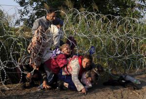Migranti siriani al confine tra Ungheria e Serbia (Bernadett Szabo, ReutersContrasto