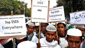 Activists from a Muslim group hold placards during a protest rally against the Paris attacks in Kolkata