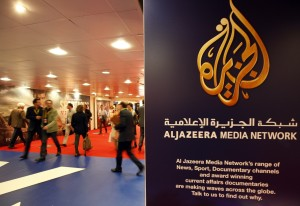 The logo of  Al Jazeera Media Network is seen at the MIPTV, the International Television Programs Market, event in Cannes