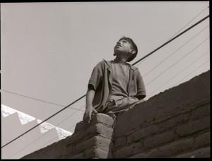 Boy-on-a-Fence-Looking-at-the-Sky-Manuel-Alvarez-Bravo