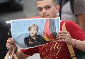 Migrants Arrive In Germany Following Ordeal In Hungary