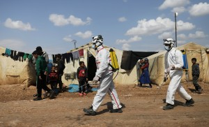 Members of the Syrian Civil defence sanitize the Bab Al-Nour internally displaced persons camp, to prevent the spread of coronavirus disease (COVID-19) in Azaz
