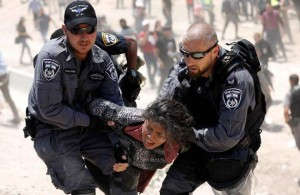 israeli-policemen-detain-a-palestinian-girl-in-khan-al-ahmar-west-bank-on-4-july-2018-reuters